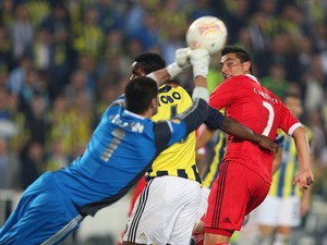 Fenerbahce's goalkeeper Volkan Demirel makes a save during the Europa League match against Benfica on April 25, 2013