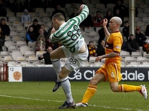 Celtic's Gary Hooper scores against Motherwell on April 28, 2013