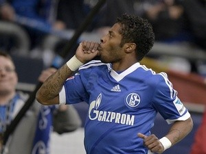 Schalke's Michel Bastos celebrates a goal against Hamburg on April 28, 2013