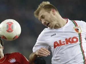 Ragnar Klavan of Augsburg in action against Bayern Munich on December 18, 2012
