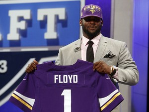 Minnesota Vikings first round draft pick Sharrif Floyd holds up his new jersey on April 25, 2013