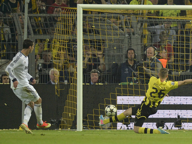 Real Madrid's Cristiano Ronaldo scores during the Champions League semi final match against Borussia Dortmund on April 24, 2013