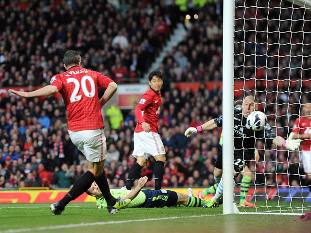 Manchester United's Robin van Persie scores his first goal against Aston Villa on April 22, 2013