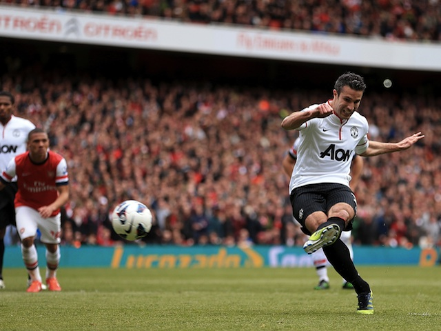United's Robin Van Persie equalises from the penalty spot against Arsenal on April 28, 2013