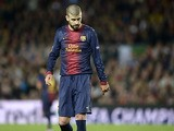 Barcelona defender Gerard Pique reacts after netting an own goal against Bayern Munich on May 1, 2013