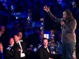 Comedian Reginald D. Hunter performs his stand-up act at the PFA awards on April 28, 2013