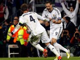 Real's Sergio Ramos is congratulated by team mates Karim Benzema after scoring his team's second against Dortmund on April 30, 2013