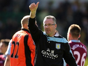 Aston Villa manager Paul Lambert acknowledges the crowd after the match against Norwich on May 4, 2013
