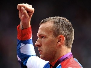Team GB's Richard Whitehead celebrates his gold medal win in the Paralympic Mens 200m at London 2012