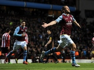 Villa skipper Ron Vlaar celebrates opening the scoring against Sunderland on April 29, 2013
