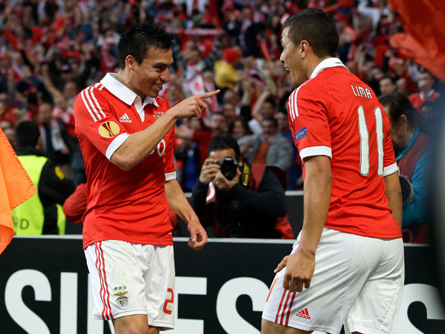 Benfica's Nicolas Gaitan celebrates with a teammate after scoring against Fenerbahce on May 2, 2013