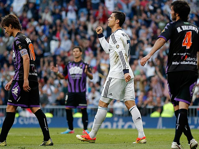 Real's Cristiano Ronaldo scores his team's second during the match against Real Valladolid on May 4, 2013