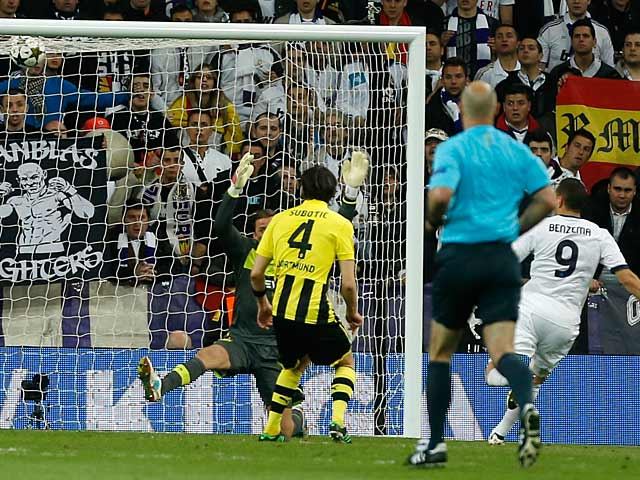 Real's Karim Benzema scores his team's first goal against Dortmund on April 30, 2013