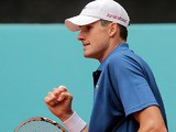 John Isner celebrates his win over Guillermo Garcia-Lopez in the Madrid Open on May 6, 2013
