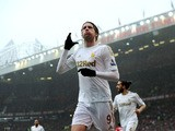 Swansea City's Miguel Michu celebrates scoring against Manchester United on May 12, 2013