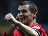Roy Keane smiling after scoring a goal for Manchester United.