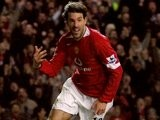 Ruud van Nistelrooy wheels away after scoring for Manchester United.