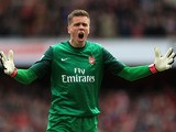 Arsenal goalkeeper Wojciech Szczesny celebrates after his side's goal against Manchester United on April 28, 2013