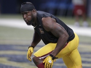 Skins' Brian Orakpo warms up before a game with the Rams on September 16, 2012