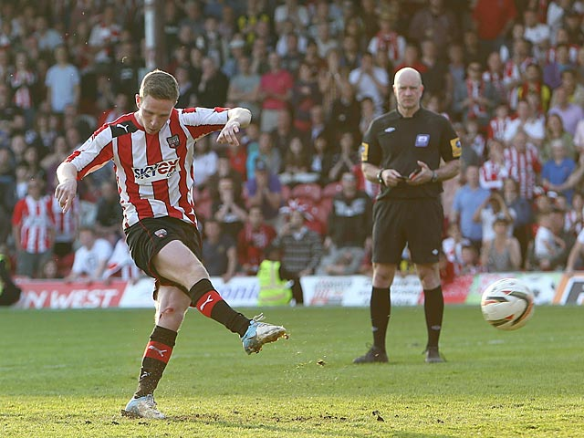 Brentford's Adam Forshaw scores the winning penalty against Swindon on May 6, 2013