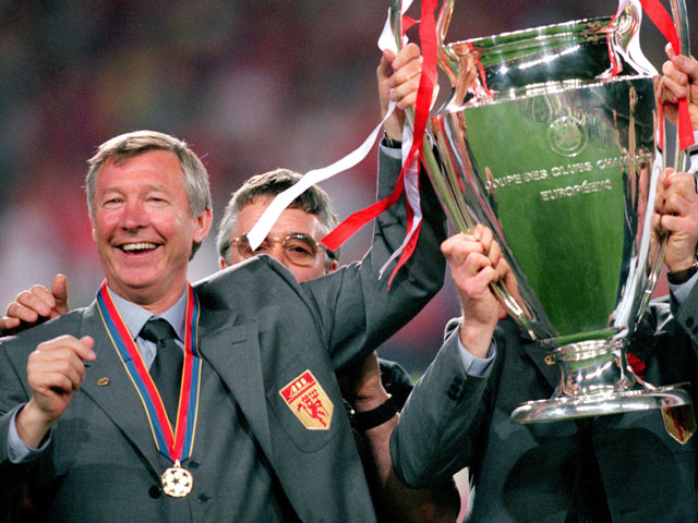 Manchester United manager Alex Ferguson celebrates with the European Cup
