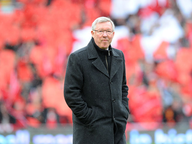 Manchester United manager Sir Alex Ferguson emerges from a guard of honour before his last home match in charge of the club on May 12, 2013