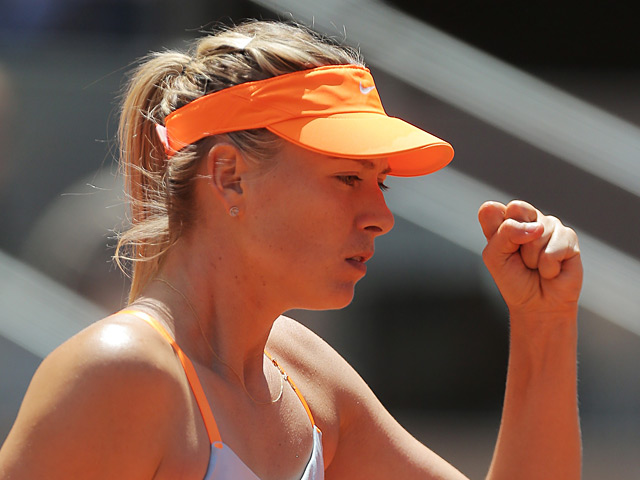Maria Sharapova celebrates after beating Ana Ivanovic in the Madrid Open semi finals on May 11, 2013