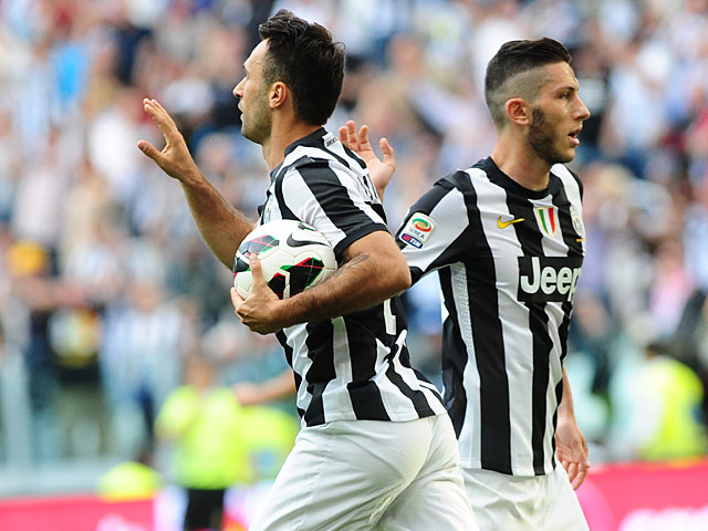 Juventus' Mirko Vucinic celebrates after scoring the equaliser against Cagliari on May 11, 2013