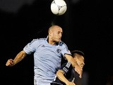 Sporting Kansas City's Aurelien Collin heads the ball on February 29, 2012