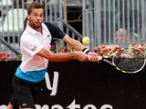 Benoit Paire returns the ball to Juan Martin Del Potro during their match at the Rome Masters on May 16, 2013
