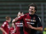 Cagliari's Daniele Dessena celebrates a goal against Lazio on May 19, 2013