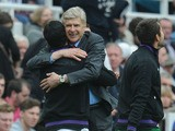 Arsenal manager Arsene Wenger celebrates after the final whistle in the Premier League match against Newcastle on May 19, 2013