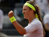 Victoria Azarenka celebrates after defeating Sara Errani in the Rome Masters on May 18, 2013