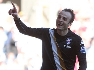 Fulham's Dimitar Berbatov celebrates scoring against Swansea on May 19, 2013