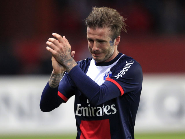 Paris Saint Germain's midfielder David Beckham cries as he leaves the field during his last ever match on May 18, 2013