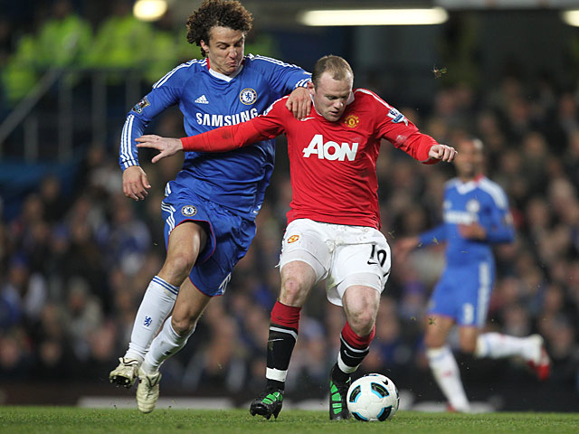 Chelsea's David Luiz and Manchester United's Wayne Rooney battle for the ball on March 1, 2011