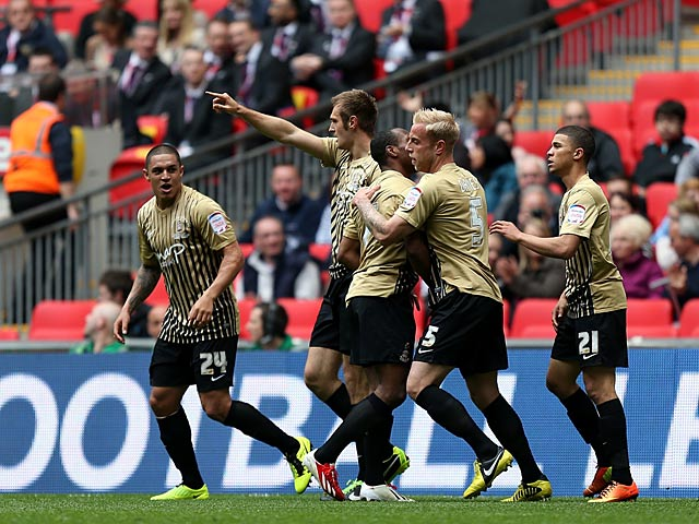 Bradford's James Hanson is congratulated by team mates after scoring the opening goal against Northampton on May 18, 2013