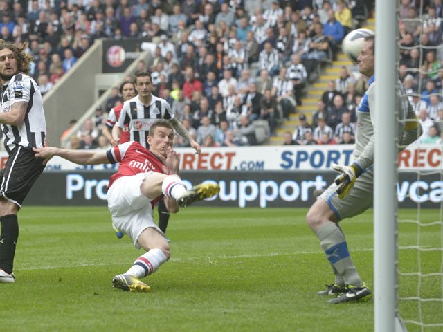 Arsenal Laurent Koscielny scores during the Premier League match against Newcastle on May 19, 2013