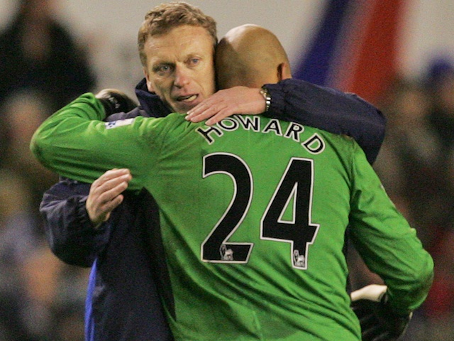 Everton boss David Moyes hugs Tim Howard after a game with Spurs on December 6, 2009