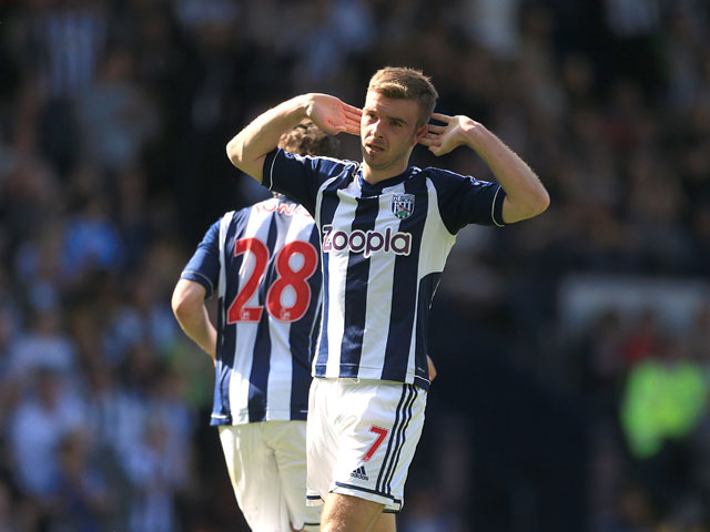 West Bromwich Albion's James Morrison celebrates scoring against Manchester United on May 19, 2013