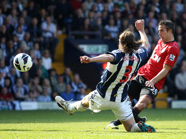 Manchester United's Robin van Persie scores his side's fourth goal against West Brom on May 19, 2013