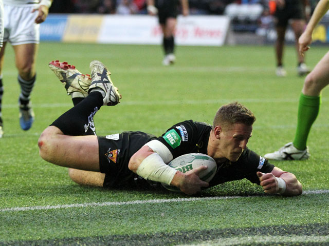 Huddersfield's Larne Patrick scores a try during the Super League against Widnes Vikings on May 17, 2013