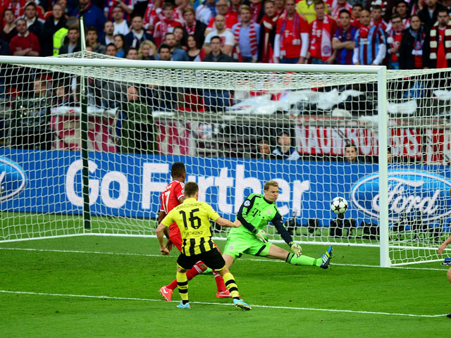 Borussia Dortmund's Jakub Blaszczykowski has his shot saved by Bayern Munich goalkeeper Manuel Neuer during the Champions League final on May 25, 2013