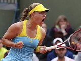 Angelique Kerber celebrates after defeating Jana Cepelova in their second round match of the French Open on May 29, 2013