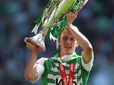 Yeovil Town's Dan Burn celebrates with the npower Football League One Play Off Final trophy on May 19, 2013