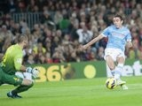 Iago Aspas takes a shot against Barcelona.