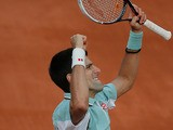 Novak Djokovic celebrates after defeating Grigor Dimitrov during their third round match of the French Open on June 1, 2013