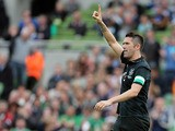 Ireland's Robbie Keane celebrates after scoring his team's third goal against Georgia in a friendly match on June 2, 2013