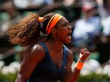 Serena Williams celebrates after defeating Roberta Vinci during their fourth round match of the French Open on June 2, 2013