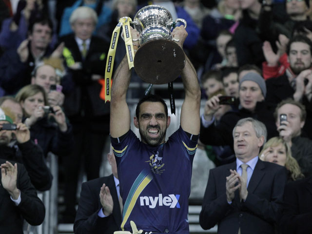 Australia's captain Adam Goodes lifts the International rules series trophy on October 30, 2010